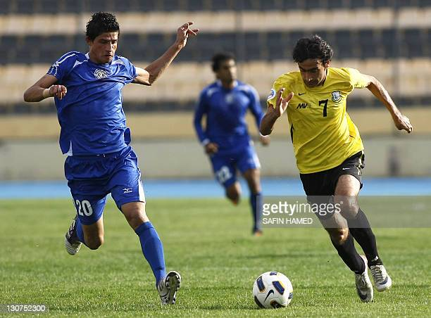 Arbil's Club's player Halgord Mulla Muhammed vies for the ball against AlTalaba Club's Ahmed Jabar during the opening match of the Iraqi League...