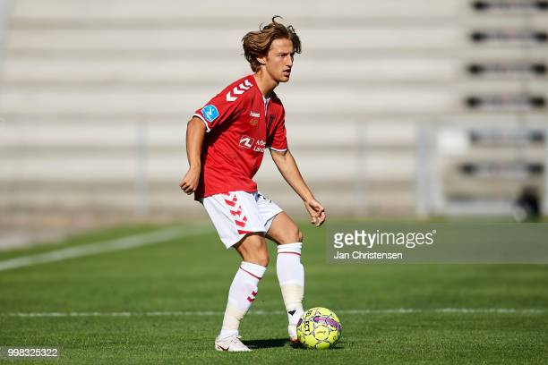 Arbnor Mucolli of Vejle Boldklub controls the ball during the Danish Superliga match between Vejle Boldklub and Hobro IK at Vejle Stadion on July 13...