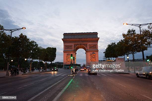 Arc De Triomphe Against Sky During Sunset In City