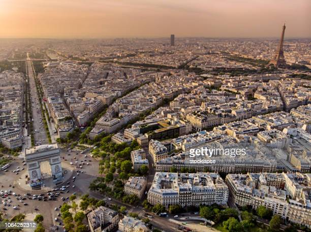 arc de triomphe and eiffel tower in paris at sunrise - triumphal arch stock photos and pictures