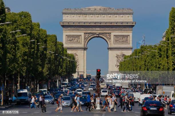 Arc de Triomphe Arch of Triumph as seen during the day Paris