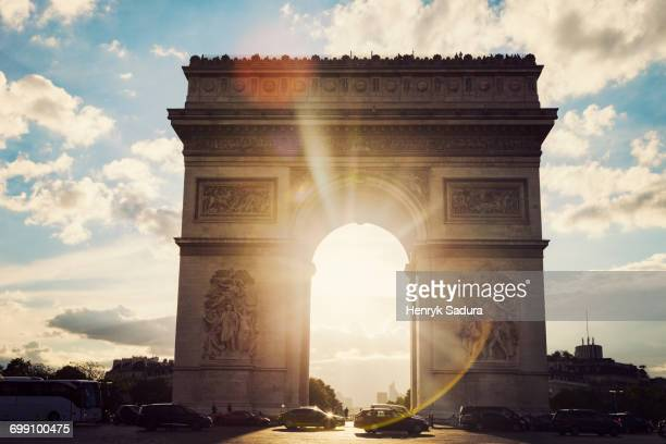 Arc de Triomphe in Paris seen at sunset. Paris, France