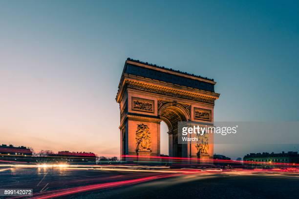 arc de triumph - avenue des champs elysees stock photos and pictures