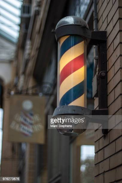 arcade barbers - barber pole stock photos and pictures