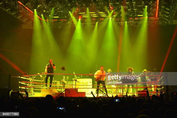 Arcade Fire perform live on stage during their 'Everything Now' tour at SSE Arena on April 11 2018 in London England