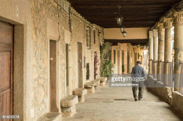 arcade (public space) in the village of cuacos de yuste, western spain - town stock pictures, royalty-free photos & images