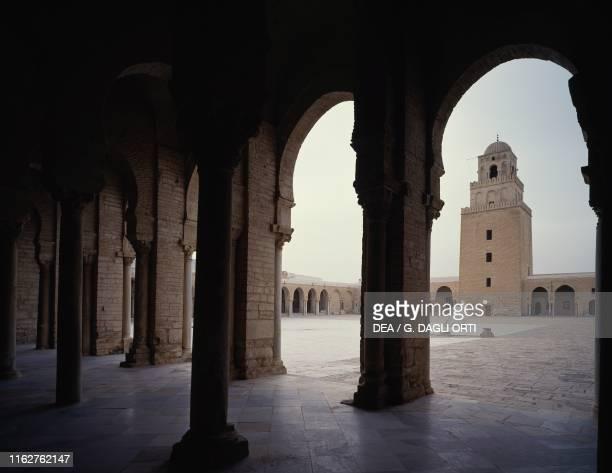 Arcade, inner courtyard and minaret of the Great Mosque of Sidi-Uqba , Kairouan, Tunisia, 8th-9th century.