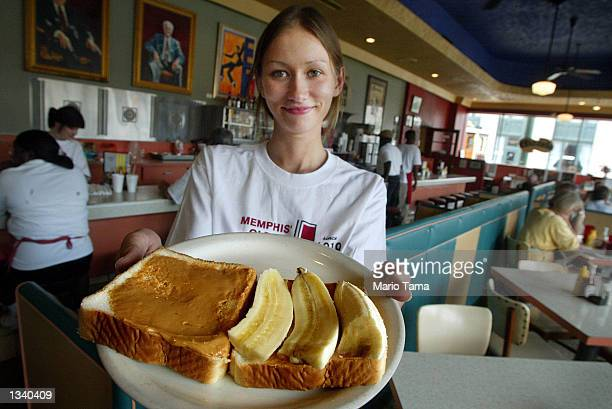 Arcade restaurant waitress Julia Flowers holds a peanut butter and banana sandwich Elvis Presley's favorite snack on the 25th anniversary of...