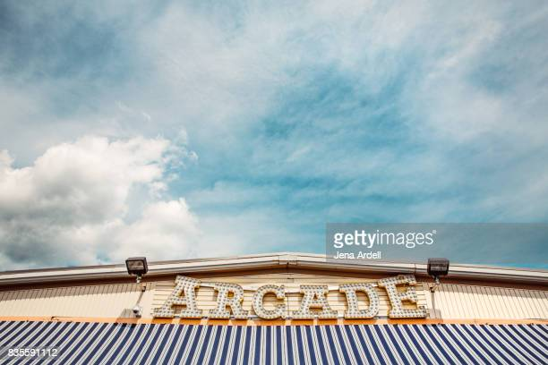 arcade sign on the boardwalk - arcade stock photos and pictures