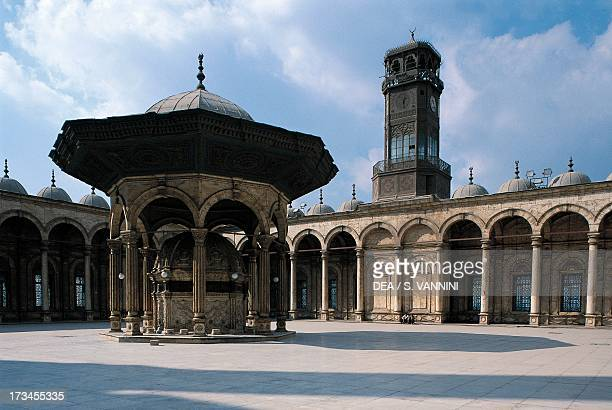 Arcaded courtyard ablution fountain and clock tower Muhammad Ali Mosque Cairo Egypt