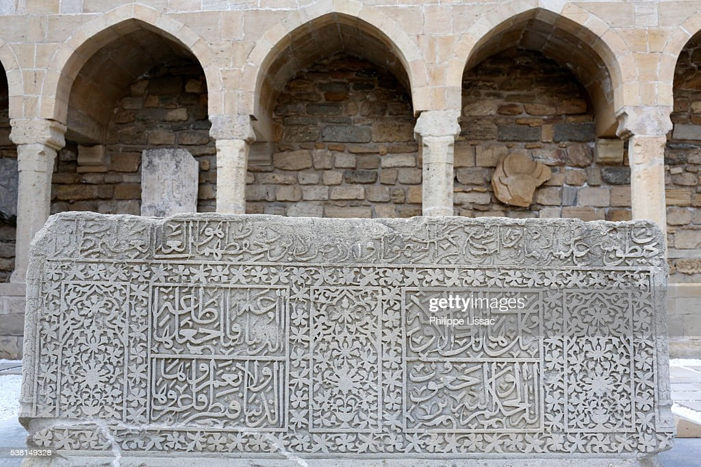 Arcades and religious burial place in Baku's old city. Gravestone, 1459. This is the tomb of the deaceased happy martyr Emir Tahmuraz Bin Sheikh Bahlul Koran II, 256 : Stock Photo