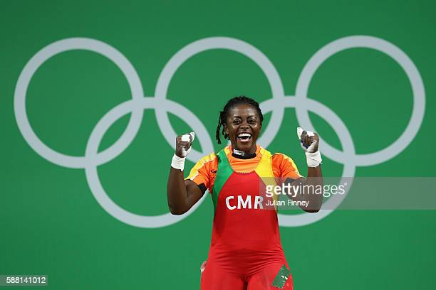 Arcangeline Fouodji Sonkbou of Cameroon celebrates after lifting during the Women's 69kg Group B weightlifting contest on Day 5 of the Rio 2016...