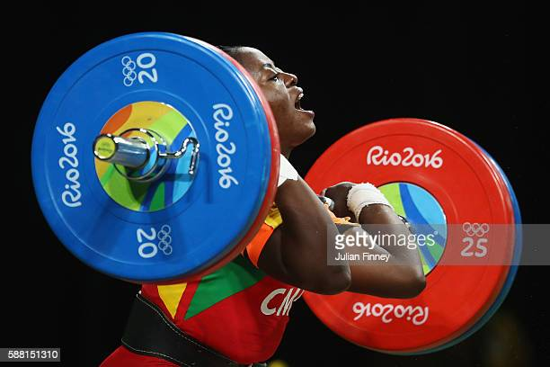 Arcangeline Fouodji Sonkbou of Cameroon lifts during the Women's 69kg Group B weightlifting contest on Day 5 of the Rio 2016 Olympic Games at...