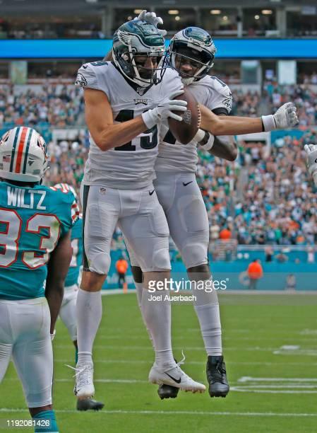 J ArcegaWhiteside celebrates his touchdown with Alshon Jeffery of the Philadelphia Eagles xx of the Miami Dolphins during an NFL game on December 1...