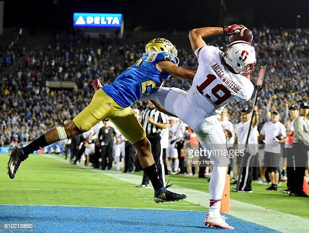 ArcegaWhiteside of the Stanford Cardinal makes a catch for a touchdown past Nate Meadors of the UCLA Bruins to take a 1513 lead during the fourth...