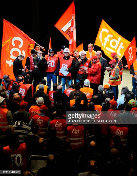 ArcelorMittal's unionists speak to employees at a general meeting to propose future actions, on March 12, 2012 in Florange, northeastern France....