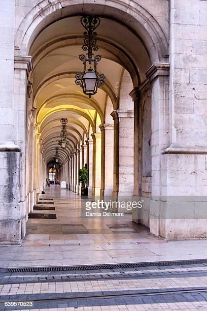 Arch and columns in a row near Rua Augusta Arch, Lisbon, Portugal