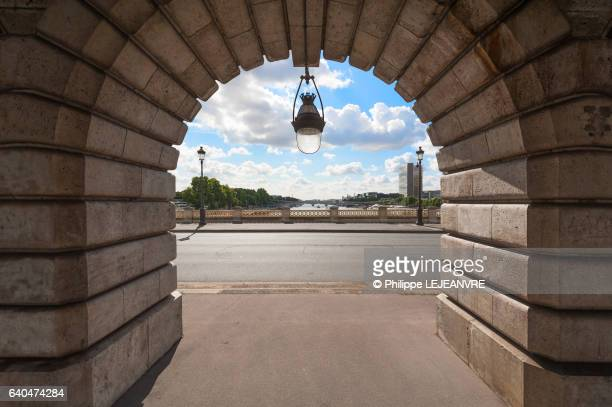 arch and lamppost under the bercy bridge in paris - arch stock pictures, royalty-free photos & images
