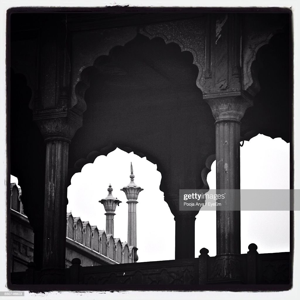 Arch And Minaret In Jama Masjid Against Clear Sky : Stock Photo