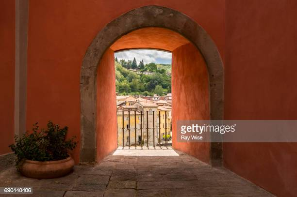 Arch and town view in Castelnuovo di Garfagnana, Tuscany.