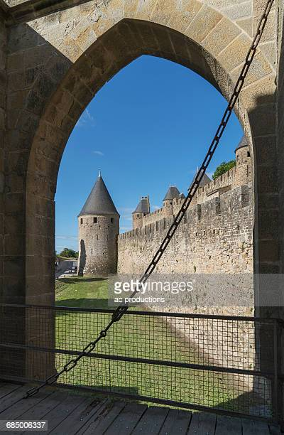 Arch behind gate at castle in Carcassonne, Languedoc-Roussillon, France