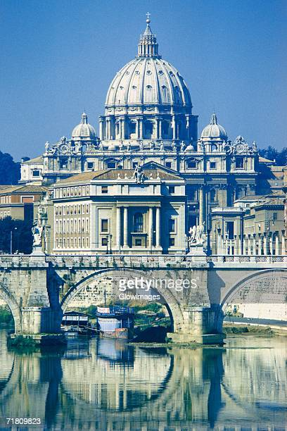 Arch bridge across a river in front of a basilica, St. Peter's Basilica, Vatican City