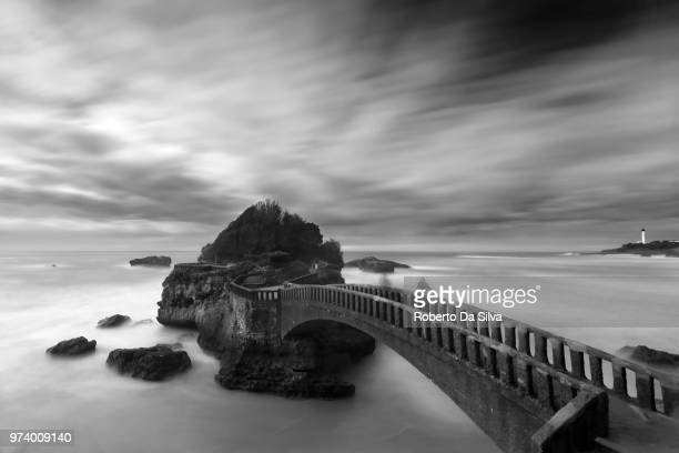 arch bridge and cloudscape, biarritz, france - biarritz stock pictures, royalty-free photos & images
