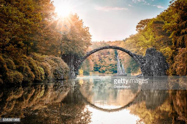arch bridge (rakotzbrucke) at autumn - saxony stock pictures, royalty-free photos & images