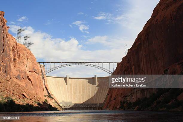 arch bridge by hoover dam against sky - hoover dam stock photos and pictures