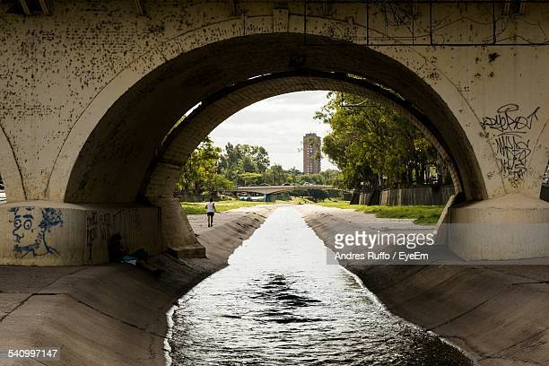 Arch Bridge On Canal In City