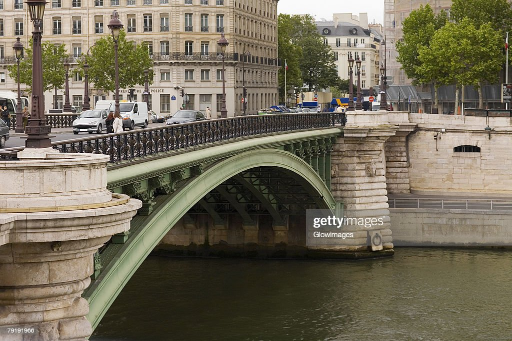 Arch bridge over a river, Paris, France : Stock Photo