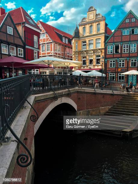 arch bridge over canal in city against sky - stade germany stock pictures, royalty-free photos & images