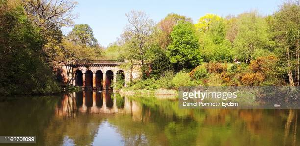 arch bridge over lake against sky - hampstead heath stock pictures, royalty-free photos & images
