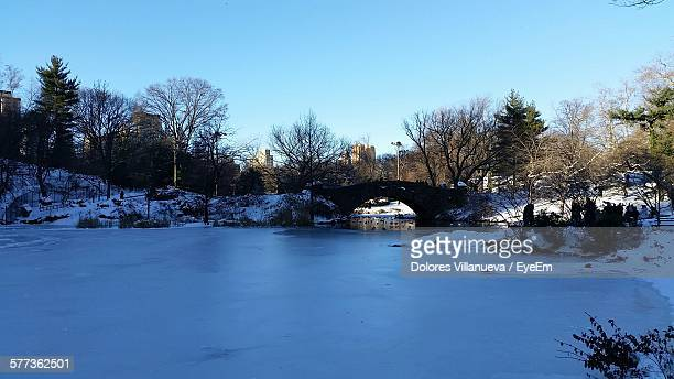 Arch Bridge Over Lake At Central Park During Winter Season