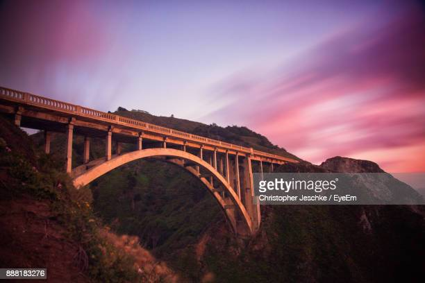 Arch Bridge Over Mountain Against Sky