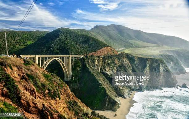 arch bridge over mountains against sky - jesse stock pictures, royalty-free photos & images