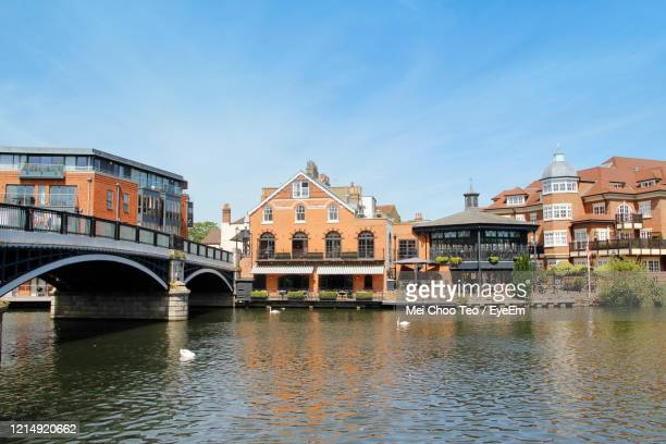 arch bridge over river against buildings - windsor england stock pictures, royalty-free photos & images
