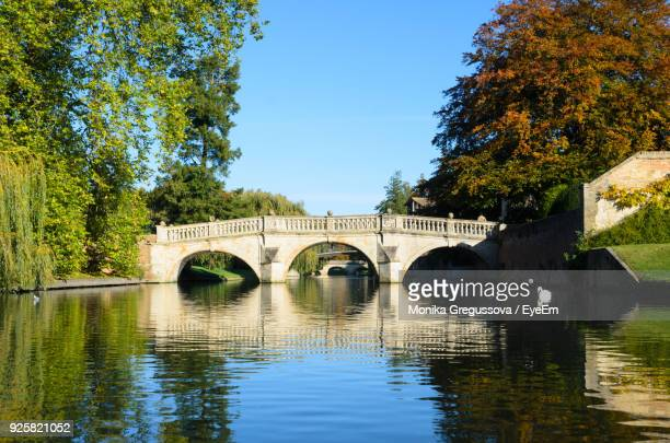 arch bridge over river against clear sky - monika gregussova stock pictures, royalty-free photos & images