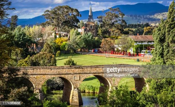 arch bridge over river against cloudy sky - hobart tasmania stock pictures, royalty-free photos & images