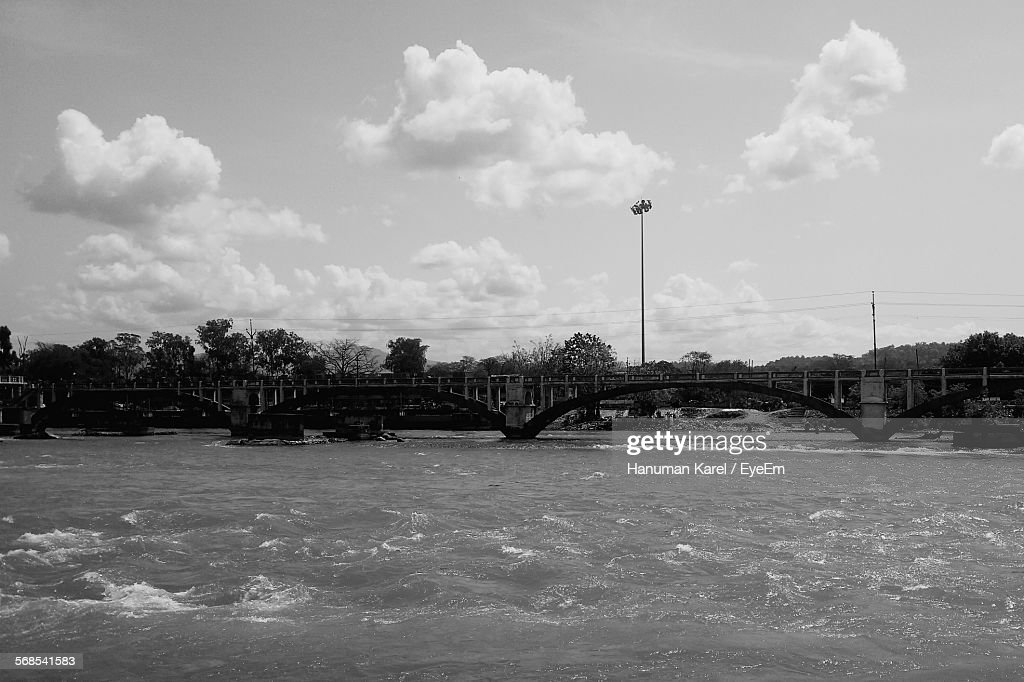 Arch Bridge Over River Against Sky : Stock Photo