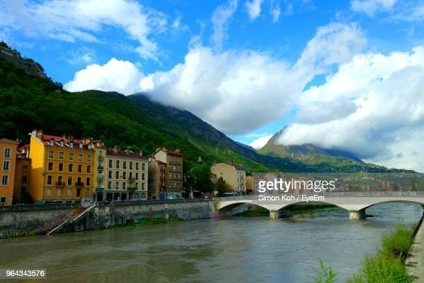 arch bridge over river by buildings against sky - auvergne rhône alpes stock pictures, royalty-free photos & images