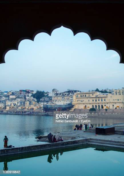 arch bridge over river in city - pushkar stock pictures, royalty-free photos & images