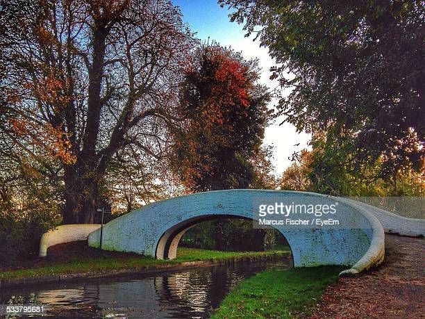 arch bridge over river - bedfordshire stock photos and pictures