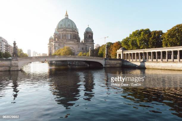 arch bridge over river - central berlin stock photos and pictures