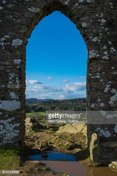 arch door of old ruin against blue sky - leicester stock pictures, royalty-free photos & images