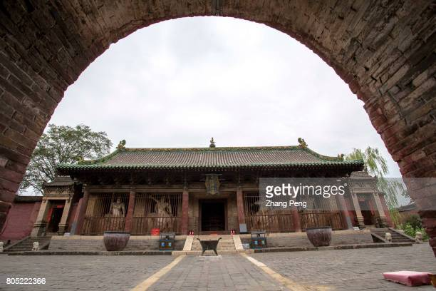 Arch gate leading to the Mahavira Hall The Shuanglin Temple is famous for more than 2000 colorful well preserved sculptures left from the Song Yuan...