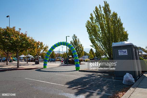 Arch of colored balloons marking the end of a race course in Heather Farms Park in the San Francisco Bay Area town of Walnut Creek California for a...