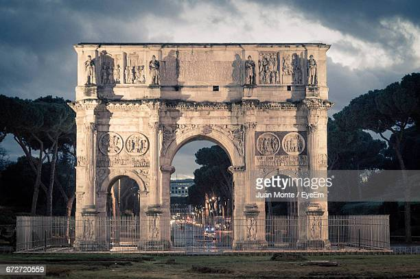Arch Of Constantine Against Cloudy Sky At Dusk
