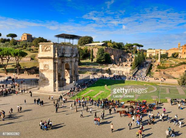 Arch of Constantine and Arch of Titus are seen at the Colosseum on October 31 2017 in Rome Italy Rome is one of the most popular tourist destinations...