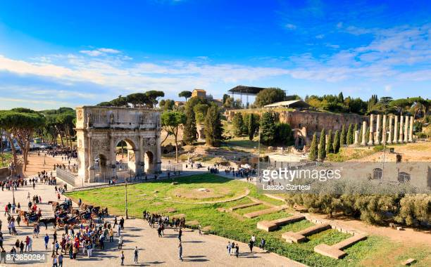Arch of Constantine and The Palatine Hill are seen at the Colosseum on October 31 2017 in Rome Italy Rome is one of the most popular tourist...